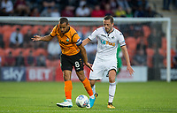 Gylfi Sigurosson of Swansea City & Curtis Weston of Barnet during the 2017/18 Pre Season Friendly match between Barnet and Swansea City at The Hive, London, England on 12 July 2017. Photo by Andy Rowland.