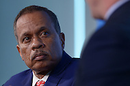 Washington, DC - April 8, 2014:  Fox News political analyst Juan Williams (c) moderates a panel discussion as part of the Aspen Institute's 'Symposium on The State of Race in America' at the Newseum in the District of Columbia. (Photo by Don Baxter/Media Images International)
