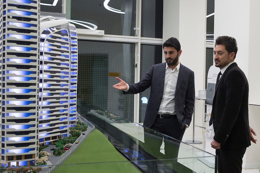 Halit Acar, left, with his colleague Ferhat Akkoyunlu next to the model of the Iconova project, seven luxury apartment towers being built on the edge of Gaziantep.