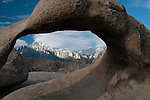 A view of the Eastern Sierra Range including Mt. Whitney, through a natural arch