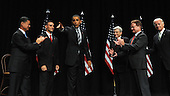 Fairfax, VA - August 3, 2009 -- United States President Barack Obama waves after speaking during an event to mark the implementation of the Post-9/11 GI Bill at George Mason University in Fairfax, Virginia on Monday, August 3, 2009. On stage from left are U.S. Secretary of Veterans Affairs General Eric Shinseki, Marine Corps Staff Sergeant James Miller, Obama, former U.S. Senator John Warner (Republican of Virginia), U.S. Senator Jim Webb (Democrat of Virginia) and Vice President Joseph Biden.  .Credit: Roger L. Wollenberg / Pool via CNP