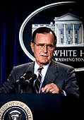 United States President George H.W. Bush holds a press conference on the crisis with Iraq in the Brady Press Briefing Room at the White House in Washington, DC on August 17, 1990. <br /> Credit: Howard L. Sachs / CNP