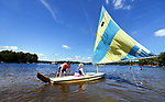 Middlebury, CT- 13 August 2017-081317CM01-   Ken Klinefelter of Bethel, left, gives instructions during a sailing lesson at the Lake Quassepaug Outing Club in Middlebury on Sunday. Clear skies and mild winds provided the sailors a pleasant afternoon on the water.   According to the National Weather Service, Monday is expected to be seasonable with highs in the lower to mid 80s.    Christopher Massa Republican-American