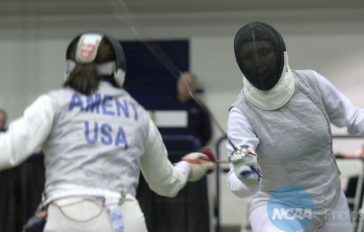 22 MAR 2002:  Andrea Ament, of Notre Dame, (L), and Alicja Kryczalo, (R) also of Notre Dame, battle during the women's foil finals of the NCAA Fencing Championship held in the William E. and Carol G. Simon Forum at Drew University in Madison, NJ. Alicja Kryczalo, of Notre Dame, defeated Andrea Ament, also of Notre Dame, 15-6. John Munson/NCAA Photos