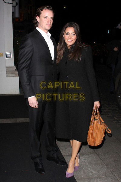 JAMES PETRIE & LAILA ROUASS.At the Inspirational Women Of The Year Awards, Marriott Hotel, Grosvenor Square, London, England, UK, November 23rd 2010..full length black coat tan brown bag suit white shirt purple couple suede shoes .CAP/AH.©Adam Houghton/Capital Pictures.