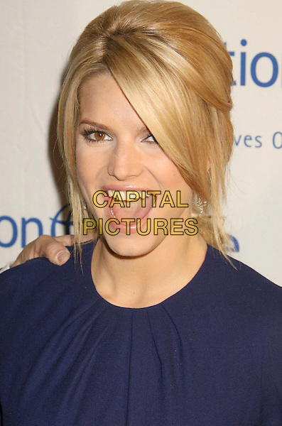 "JESSICA SIMPSON.25th Annual ""Operation Smile"" Benefit Gala held at the Beverly Hills Hotel, Beverly Hills, California, USA, .5 October 2007..portrait headshot smiling mouth open funny.CAP/ADM/RE.©Russ Elliot/AdMedia/Capital Pictures."
