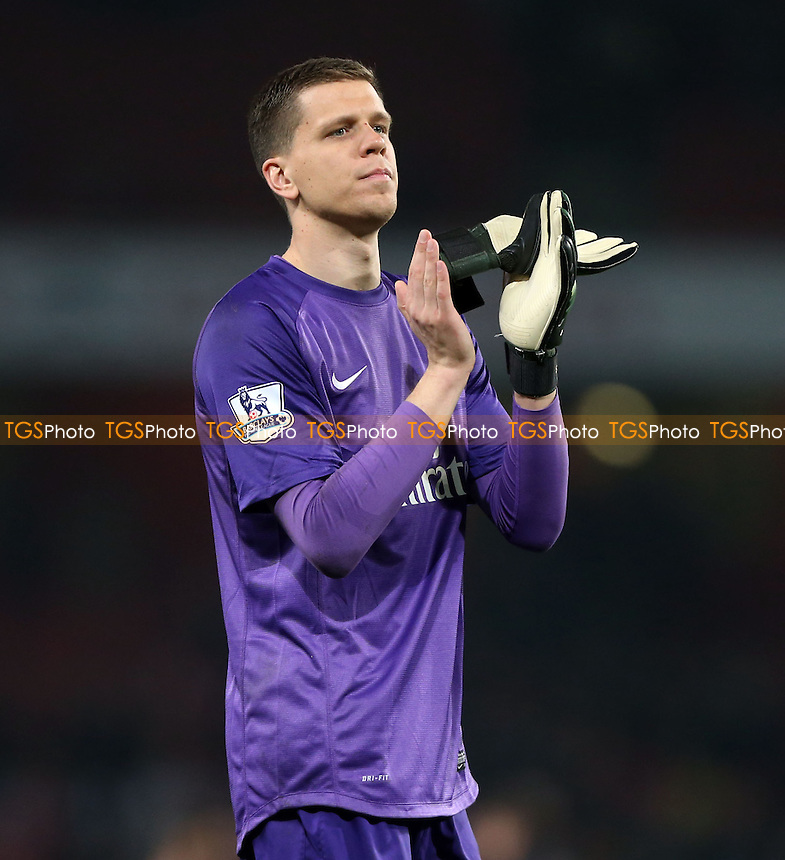 Wojciech Szczesny applauds the Arsenal fans at the end of the game - Arsenal vs Newcastle United, Barclays Premier League at The Emirates Stadium, Arsenal - 28/04/14 - MANDATORY CREDIT: Rob Newell/TGSPHOTO - Self billing applies where appropriate - 0845 094 6026 - contact@tgsphoto.co.uk - NO UNPAID USE