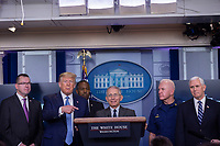 United States President Donald J. Trump, second left, gestures towards Director of the National Institute of Allergy and Infectious Diseases at the National Institutes of Health Dr. Anthony Fauci, third right, as he makes remarks on the Coronavirus crisis in the Brady Press Briefing Room of the White House in Washington, DC on Saturday, March 21, 2020.  From left to right: Pete Gaynor, Administrator, Federal Emergency Management Agency (FEMA); the President; US Secretary of Housing and Urban Development (HUD) Ben Carson; Dr. Fauci; Admiral Brett Giroir, USAssistant Secretary for Health and US Vice President Mike Pence.<br /> Credit: Stefani Reynolds / Pool via CNP/AdMedia