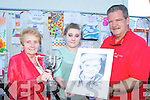 Sheila Courtney presents the Michael Courtney memorial cup to Katie Mai Moloney Killarney the overall winner of the Bird's Amusement's Carnival week art competition on Saturday along with  Don Bird
