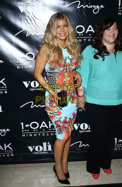 Fergie (Stacy Ferguson).Fergie Celebrates Her Birthday at 1 OAK Nightclub at The Mirage Resort Hotel and Casino, Las Vegas, Nevada, USA, 30th March 2012..full length  blue turquoise floral print dress black belt waist shoes  pink orange clutch bag .CAP/ADM/MJT.© MJT/AdMedia/Capital Pictures.
