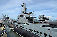 USS Pampanito, decomissioned Second World War II submarine, one of numerous tourist attactions at Fisherman's Wharf, San Francisco, California, USA. In the background is another popular attraction, the Liberty Ship, Jeremiah O'Brien, 201304131378<br /> <br /> Copyright Image from Victor Patterson, 54 Dorchester Park, Belfast, UK, BT9 6RJ<br /> <br /> Tel: +44 28 9066 1296<br /> Mob: +44 7802 353836<br /> Voicemail +44 20 8816 7153<br /> Skype: victorpattersonbelfast<br /> Email: victorpatterson@me.com<br /> Email: victorpatterson@ireland.com (back-up)<br /> <br /> IMPORTANT: If you wish to use this image or any other of my images please go to www.victorpatterson.com and click on the Terms &amp; Conditions. Then contact me by email or phone with the reference number(s) of the image(s) concerned.