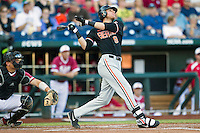 Oregon State first baseman Danny Hayes (9) follows through on his swing against the Indiana Hoosiers during Game 9 of the 2013 Men's College World Series  on June 19, 2013 at TD Ameritrade Park in Omaha, Nebraska. The Beavers defeated the Hoosiers 1-0, eliminating Indiana from the tournament. (Andrew Woolley/Four Seam Images)