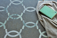 Seine, a stone waterjet mosaic in Montevideo honed and Kays Green polished.