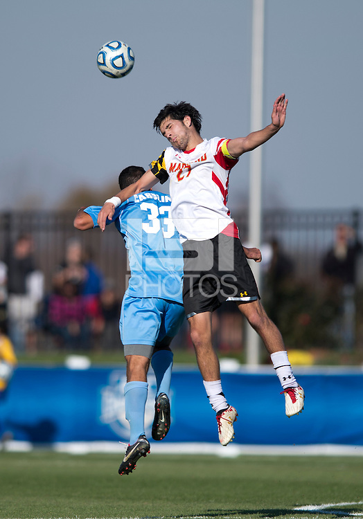 John Stertzer (27) of Maryland goes up for a header with Raby George (33) of North Carolina during the game at the Maryland SoccerPlex in Germantown, MD. Maryland defeated North Carolina, 2-1,  to win the ACC men's soccer tournament.