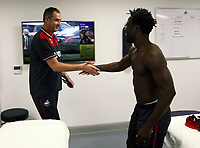 Pictured: Wilfried Bony is greeted by manager Paul Clement during his medical with club physiotherapist Kate Rees at the Fairwood Training Ground, Wales, UK. Thursday 31 August 2017<br /> Re: Wilfried Bony has signed a contract with Swansea City FC.