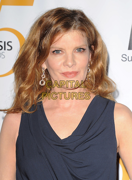 RENE RUSSO .at The Humane Society of The United States celebration of The 25th Anniversary Genesis Awards in Beverly Hills, California, USA, .March 19th 2011..portrait headshot black navy blue earrings gold  sleeveless beauty                                                  .CAP/RKE/DVS.©DVS/RockinExposures/Capital Pictures.