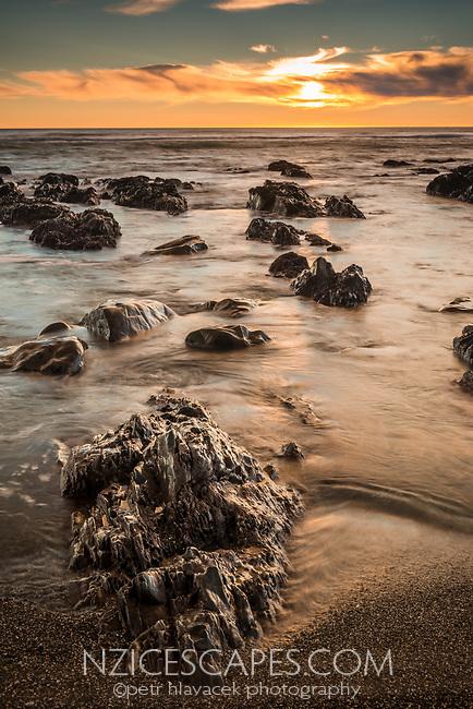 Sunset over rock formations near Rapahoe near Greymouth, Buller Region, West Coast, South Island, New Zealand, NZ