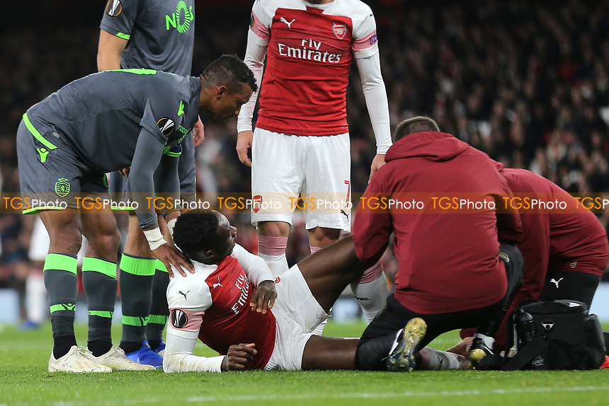 Nani of Sporting Lisbon consoles Arsenal's Danny Welbeck who receives treatment prior to being stretchered off during Arsenal vs Sporting Lisbon, UEFA Europa League Football at the Emirates Stadium on 8th November 2018