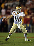 Los Angeles, CA 11/25/06 - Brady Quinn is flused out of the pocket during the first quarter of play<br />