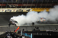 Oct. 17, 2009; Concord, NC, USA; NASCAR Sprint Cup Series driver Sam Hornish Jr (77) spins during the NASCAR Banking 500 at Lowes Motor Speedway. Mandatory Credit: Mark J. Rebilas-