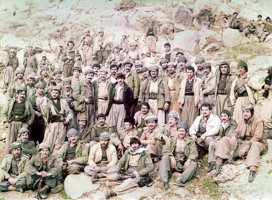 Iraq 1985 <br /> Group of peshmergas after the battle of Daban, near Sergalou. The chiefs of PUK are present, among them, Mullazem Omar, Mahmoud Sangawi, Arsalan Baez  <br /> Irak 1985 <br /> Groupe de peshmergas apres la bataille de Daban, pres de Sergalou avec les chefs de l'UPK parmi lesquels, Mullazem Omar, Mahmoud Sangawi, Arsalan Baez