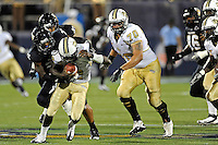 17 September 2011:  FIU linebacker Jordan Hunt (25) brings down UCF quarterback Jeff Godfrey (2) in the second half as the FIU Golden Panthers defeated the University of Central Florida Golden Knights, 17-10, at FIU Stadium in Miami, Florida.