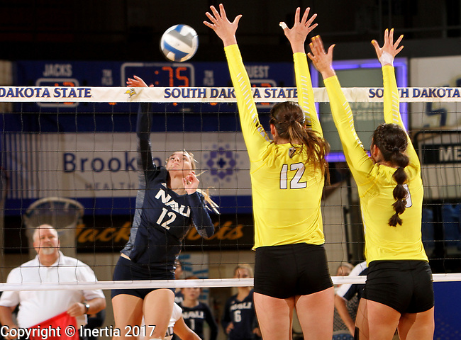 BROOKINGS, SD - SEPTEMBER 1: Kaylie Jorgenson #12 from Northern Arizona looks to get a kill past Taylor Graboski #12 and Brittany Anderson #9 from Valparaiso during their match Friday afternoon at the Jackrabbit Invitational at Frost Arena in Brookings. (Photo by Dave Eggen/Inertia)