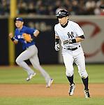 (R-L) Ichiro Suzuki (Yankees), Munenori Kawasaki (Blue Jays),.APRIL 26, 2013 - MLB :.Ichiro Suzuki of the New York Yankees leads off of second base as shortstop Munenori Kawasaki of the Toronto Blue is seen in the background during the baseball game at Yankee Stadium in The Bronx, New York, United States. (Photo by AFLO)