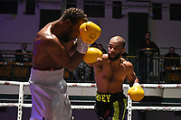 Ish O'Connor (black shorts) defeats Jordan Grannum during a Boxing Show at York Hall on 8th June 2019