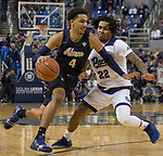 Akron guard Tyler Cheese (4) drives past Nevada's Jazz Johnson (22) in the second half of an NCAA college basketball game in Reno, Nev., Saturday, Dec. 22, 2018. (AP Photo/Tom R. Smedes)