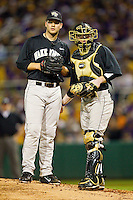 Austin Stadler #9 and Mike Lubanski #10 of the Wake Forest Demon Deacons meet on the mound during the first inning against the LSU Tigers at Alex Box Stadium on February 18, 2011 in Baton Rouge, Louisiana.  The Tigers defeated the Demon Deacons 15-4.  Photo by Brian Westerholt / Four Seam Images