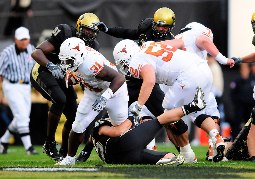 04 October 2008: Texas fullback Cody Johnson tries to avoid a tackle by Colorado linebacker Jeff Smart (45). The Texas Longhorns defeated the Colorado Buffaloes 38-14 at Folsom Field in Boulder, Colorado. For Editorial Use Only