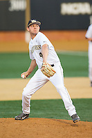 Wake Forest Demon Deacons relief pitcher John McCarren (45) in action against the High Point Panthers at Wake Forest Baseball Park on April 2, 2014 in Winston-Salem, North Carolina.  The Demon Deacons defeated the Panthers 10-6.  (Brian Westerholt/Four Seam Images)