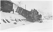 RGS 4-6-0 #25 derailed into Lightner Creek with the tender on its side on the roadbed.<br /> RGS  West Durango, CO  Taken by Ballough, Monte - 12/31/1919