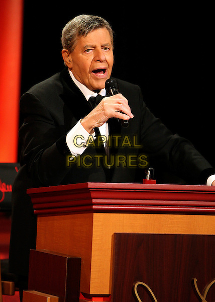 JERRY LEWIS.MDA Labor Day Telethon Live in Las Vegas at The South Point Hotel and Casino, Las Vegas, Nevada, USA,.31 August 2008..half length podium mouth open funny microphone .CAP/ADM/MJT.©MJT/Admedia/Capital Pictures