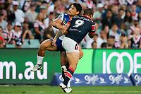 Mason Lino clashes with Jake Friend. Sydney Roosters v Vodafone Warriors, NRL Rugby League. Allianz Stadium, Sydney, Australia. 31st March 2018. Copyright Photo: David Neilson / www.photosport.nz