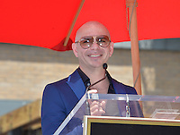 LOS ANGELES, CA. July 15, 2016: Singer Pitbull (Armando Christian Perez) on Hollywood Blvd where he was honored with the 2,584th star on the Hollywood Walk of Fame.<br /> Picture: Paul Smith / Featureflash