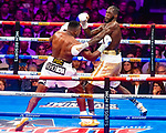"NOV 23 2019 Las Vegas Nevada: WBC Heavyweight Champion Deontay ""The Bronze Bomber"" Wilder , Tuscaloosa, AL vs Cuban slugger Luis ""King Kong"" Ortiz,   Camaguey, CUB in There 2nd Heavyweight Championship fight at the MGM Grand on FOX/PBC : photo: Wilder in Yellow Trunks/Ortiz in White trunks"