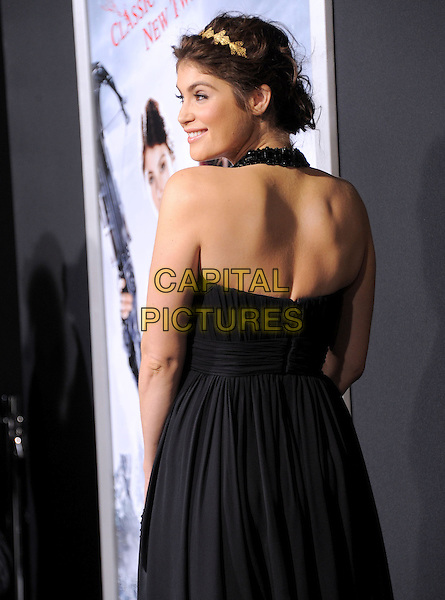 Gemma Arterton .attending the Paramount Los Angeles film premiere of 'Hansel and Gretel: Witch Hunters', held at The Grauman's Chinese Theater in Hollywood, California, USA, January 24th 2013..half length black halterneck dress side looking over shoulder rear behind  grecian ruched gold tiara crown hairband hair band                                                                    .CAP/DVS.©Debbie VanStory/Capital Pictures.