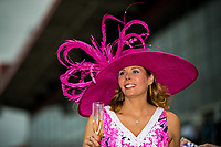 BALTIMORE, MD - MAY 20: A woman wears a festive hat while walking through the grandstand on Preakness Stakes Day at Pimlico Race Course on May 20, 2017 in Baltimore, Maryland.(Photo by Douglas DeFelice/Eclipse Sportswire/Getty Images)