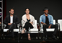 """BEVERLY HILLS - AUGUST 1: Paul Wesley, Carrie-Anne Moss, Eka Darville onstage during the """"Tell Me A Story"""" panel at the CBS All Access portion of the Summer 2019 TCA Press Tour at the Beverly Hilton on August 1, 2019 in Los Angeles, California. (Photo by Frank Micelotta/PictureGroup)"""