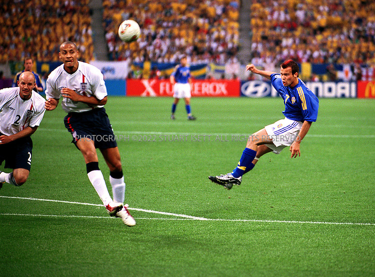 6/2/2002--Saitama, Japan..England Vs. Sweden. Sweden midfielder Fredrik Ljungberg heads the ball towards England's net in the first few minutes of Sunday's match. Despite fears in Japan of hooliganism the game went off witout a single arrest and word of trouble. Sweden produced a determined second-half display to hold England to a 1-1 draw in their opening World Cup Group F match on Sunday, maintaining a jinx going back to 1968...All photographs ©2003 Stuart Isett.All rights reserved.This image may not be reproduced without expressed written permission from Stuart Isett.