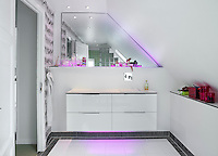 Multi-coloured LEDs have been fitted in the mirror edge and under the washbasin table base in the bathroom