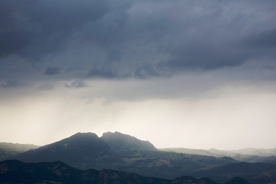 Rain clouds over the Apennines foothills seen from the city of San Marino, San Marino.