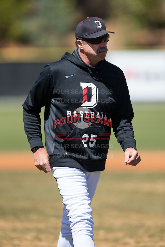 Davidson Wildcats head coach Dick Cooke (25) walks off the field after talking to his pitcher during the game against the Saint Louis Billikens at Wilson Field on March 28, 2015 in Davidson, North Carolina. (Brian Westerholt/Four Seam Images)