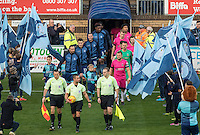 The teams head onto the pitch during the Sky Bet League 2 match between Wycombe Wanderers and Hartlepool United at Adams Park, High Wycombe, England on 26 November 2016. Photo by Kevin Prescod / PRiME Media Images.