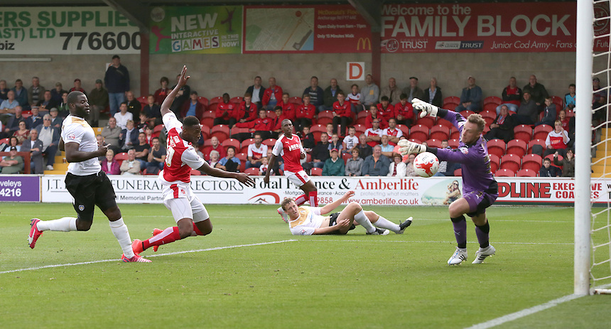 Fleetwood Town's Jamille Matt scores his sides fourth goal past Colchester United's goalkeeper Elliott Parish<br /> <br /> Photographer Stephen White/CameraSport<br /> <br /> Football - The Football League Sky Bet League One - Fleetwood Town v Colchester United - Saturday 22nd August 2015 - Highbury Stadium - Fleetwood<br /> <br /> &copy; CameraSport - 43 Linden Ave. Countesthorpe. Leicester. England. LE8 5PG - Tel: +44 (0) 116 277 4147 - admin@camerasport.com - www.camerasport.com