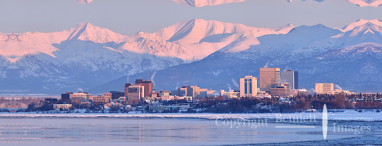 Anchorage, Alaska is painted pink by the setting sun on a bitterly cold winter day.