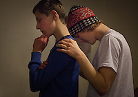 """Jeppeson holds Kasper Leibeckolesen, 15, shoulder as he prays for him during the LOUD teen service at Citykirken church. """"Loud is so much more that just God. Teens have so many problems so it's much more about letting then know about God. It's about talking to them and listening to them."""" Jeppeson said."""