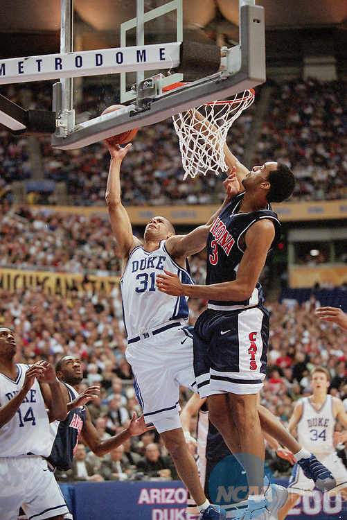02 APR 2001:  Duke forward Shane Battier (31) and University of Arizona center Loren Woods (3) during the NCAA Men's Basketball Final Four Championship game held in Minneaplois, MN at the Hubert H. Humphrey Metrodome. Duke defeated Arizona 82-72 for the championship. Also pictured Guard/forward Nate James (14). Ryan McKee/NCAA Photos
